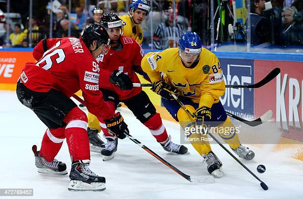Oscar Klefbom of Sweden and Damien Brunner of Switzerland battle for the puck during the IIHF World Championship group A match between Austria and...