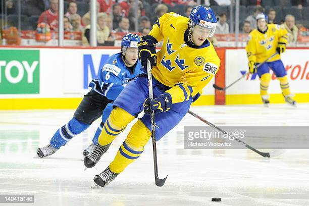 Oscar Klefbom of Team Sweden skates with the puck during the 2012 World Junior Hockey Championship Semifinal game against Team Finland at the...