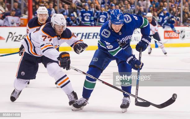 Oscar Klefbom of the Edmonton Oilers check Derek Dorsett of the Vancouver Canucks off the puck in NHL action on October 2017 at Rogers Arena in...