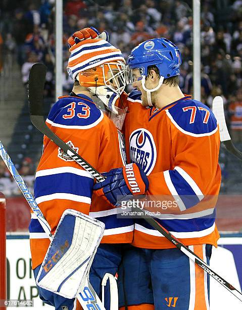 Oscar Klefbom of the Edmonton Oilers congratulates goaltender Cam Talbot after a 30 shutout over the Winnipeg Jets in the 2016 Tim Hortons Heritage...