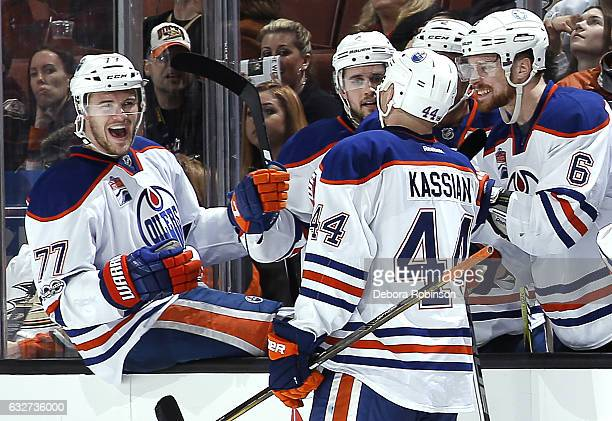 Oscar Klefbom of the Edmonton Oilers congratulates Zack Kassian after his second period goal during the game against the Anaheim Ducks on January 25...