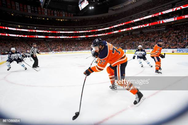 Oscar Klefbom of the Edmonton Oilers handles the puck against the Winnipeg Jets at Rogers Place on October 9 2017 in Edmonton Canada