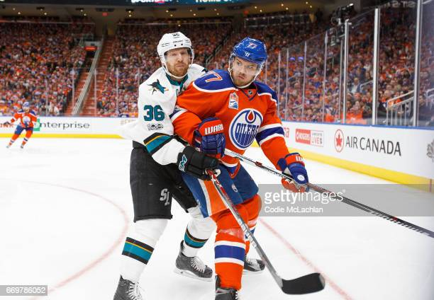 Oscar Klefbom of the Edmonton Oilers is bumped by Jannik Hansen of the San Jose Sharks in Game Two of the Western Conference First Round during the...