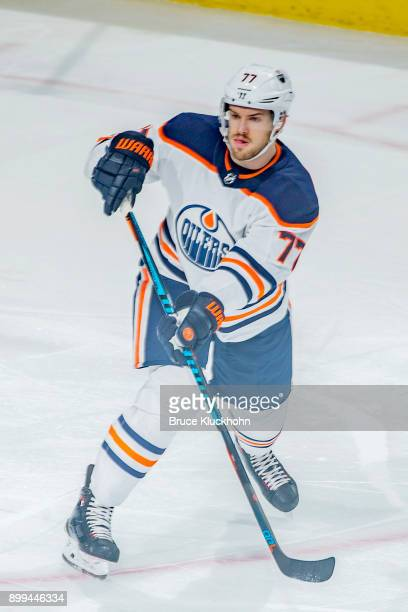 Oscar Klefbom of the Edmonton Oilers passes the puck against the Minnesota Wild during the game at the Xcel Energy Center on December 16 2017 in St...