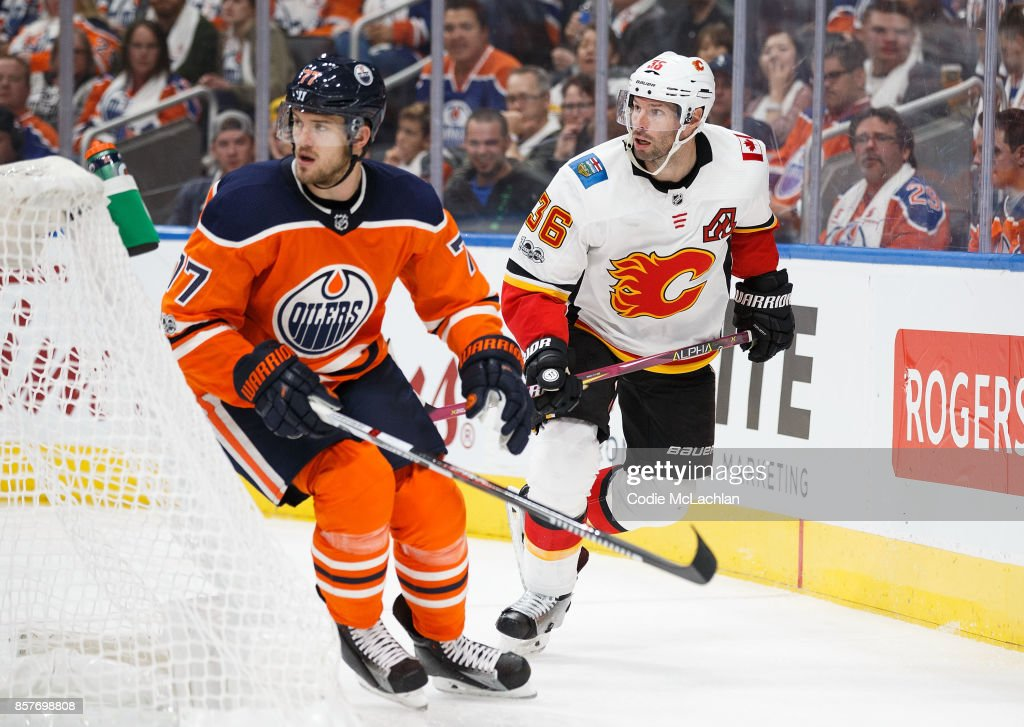 Oscar Klefbom #77 of the Edmonton Oilers skates against Troy Brouwer #36 of the Calgary Flames at Rogers Place on October 4, 2017 in Edmonton, Canada.
