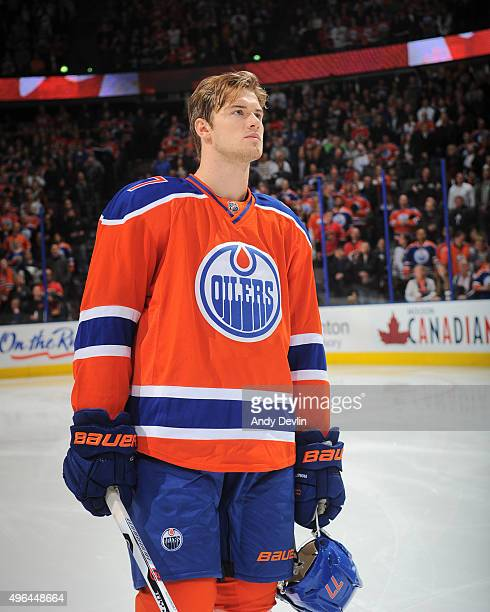 Oscar Klefbom of the Edmonton Oilers stands for the singing of the national anthem prior to a game against the Calgary Flames on October 31 2015 at...