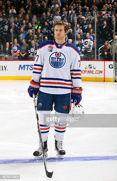 Oscar Klefbom of the Edmonton Oilers stands on the ice during the singing of 'O Canada' prior to puck drop against the Winnipeg Jets at the MTS...