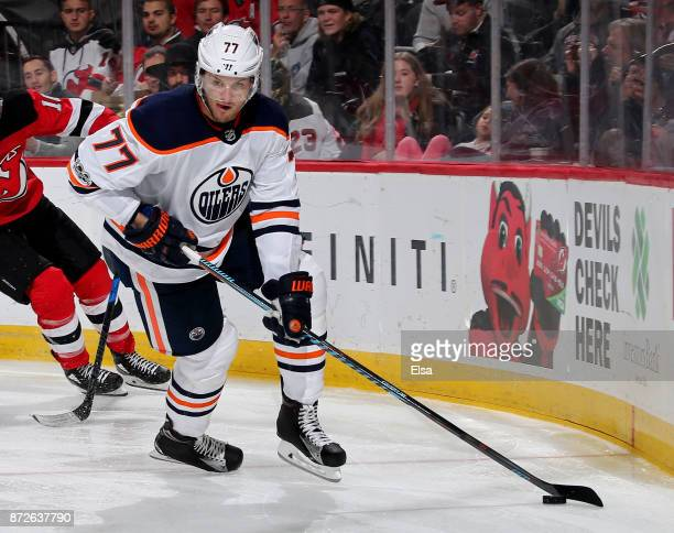 Oscar Klefbom of the Edmonton Oilers takes the puck against the New Jersey Devils on November 9 2017 at Prudential Center in Newark New Jersey