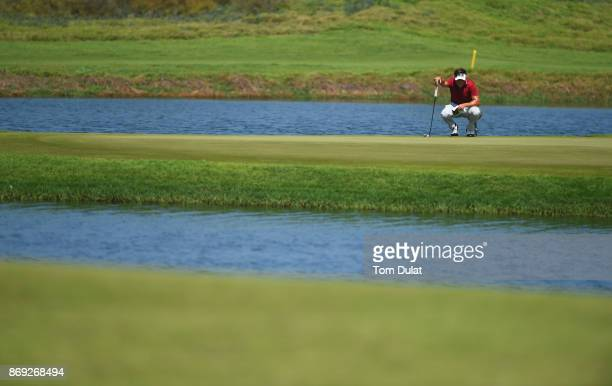 Oscar Lengden of Sweden lines up a putt on the 5th green on Day Two of the NBO Golf Classic Grand Final European Challenge Tour at Al Mouj Golf on...