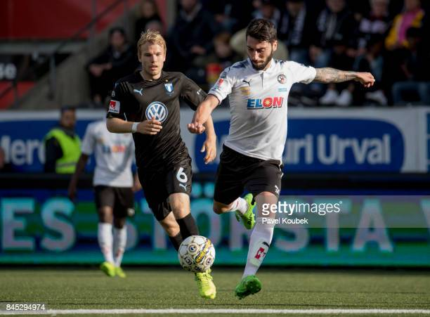 Oscar Lewicki of Malmo FF & Nahir Besara of Orebro SK during the Allsvenskan match between Orebro SK and Malmo FF at Behrn Arena on September 10,...