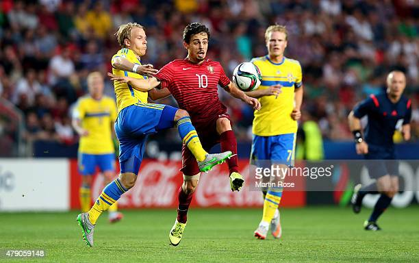 Oscar Lewicki of Sweden and Bernardo Silva of Portugal battle for the ball during the UEFA European Under21 final match between Sweden and Portugal...