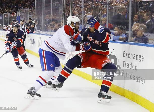 Oscar Lindberg of the New York Rangers is checked by Greg Pateryn of the Montreal Canadiens at Madison Square Garden on February 21 2017 in New York...