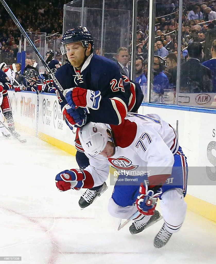 Oscar Lindberg #24 of the New York Rangers runs into Tom Gilbert #77 of the Montreal Canadiens during the second period at Madison Square Garden on November 25, 2015 in New York City.