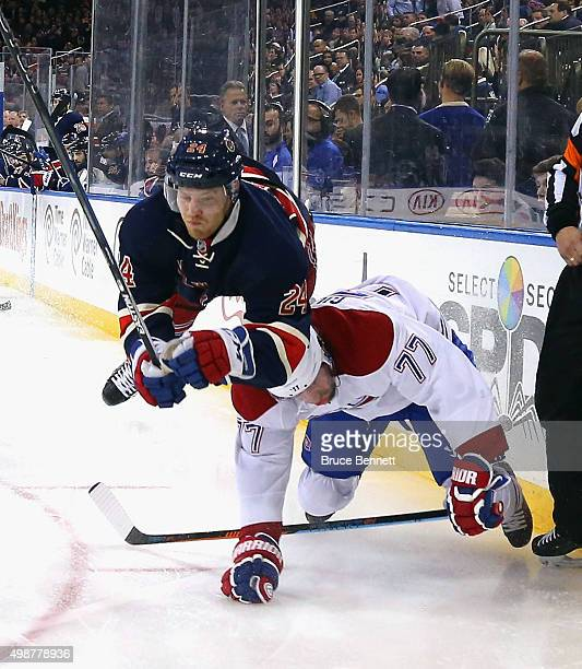 Oscar Lindberg of the New York Rangers runs into Tom Gilbert of the Montreal Canadiens during the second period at Madison Square Garden on November...