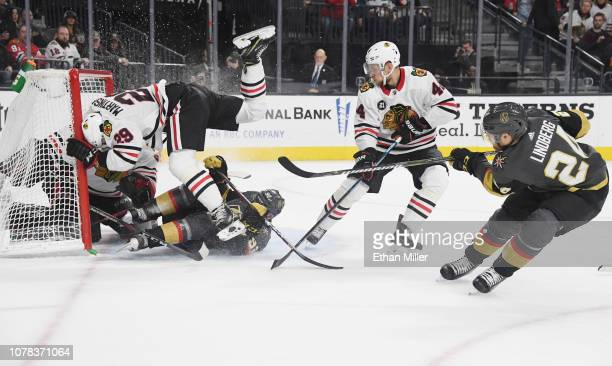 Oscar Lindberg of the Vegas Golden Knights fires a rebound into the net past Jan Rutta of the Chicago Blackhawks as Tomas Nosek of the Golden Knights...