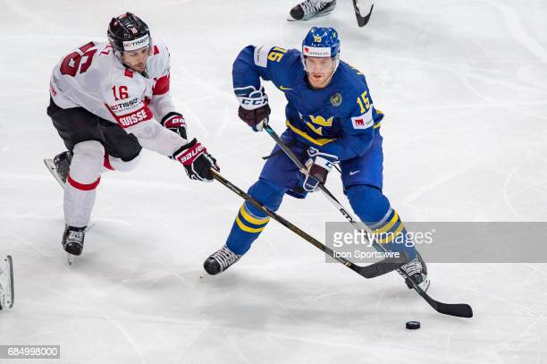 Oscar Lindberg vies with Raphael Diaz during the Ice Hockey World Championship Quarterfinal between Switzerland and Sweden at AccorHotels Arena in...