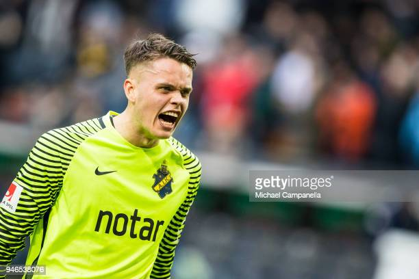 Oscar Linner of AIK celebrates AIK's 20 victory after the final whistle is blown during an Allsvenskan match between AIK and Djurgardens IF at...