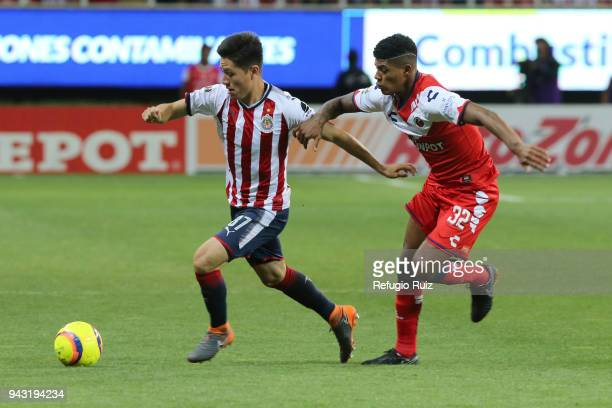 Oscar Macias of Chivas fights for the ball with Wilder Cartagena of Veracruz during the 14th round match between Chivas and Veracruz as part of the...