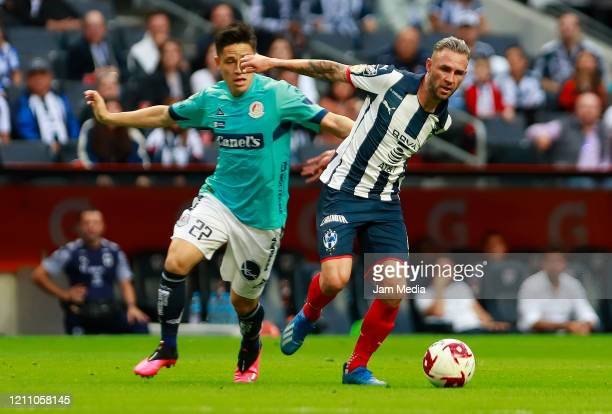 Oscar Macias of San Luis fights for the ball with Miguel Layun of Monterrey during the 9th round match between Monterrey and Atletico San Luis as...
