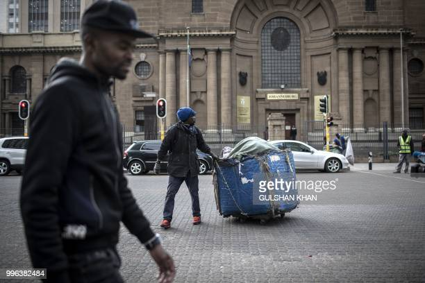 Oscar Maile pulls his trolley as he collects waste in front of the Johannesburg High Court on June 27 2018 Oscar Maile has been doing this for three...