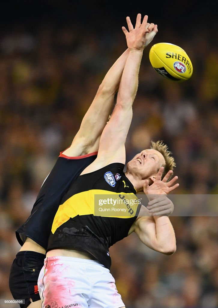 Oscar McDonald of the Demons and Jack Riewoldt of the Tigers compete for a mark during the round five AFL match between the Melbourne Demons and the Richmond Tigers at the Melbourne Cricket Ground on April 24, 2018 in Melbourne, Australia.