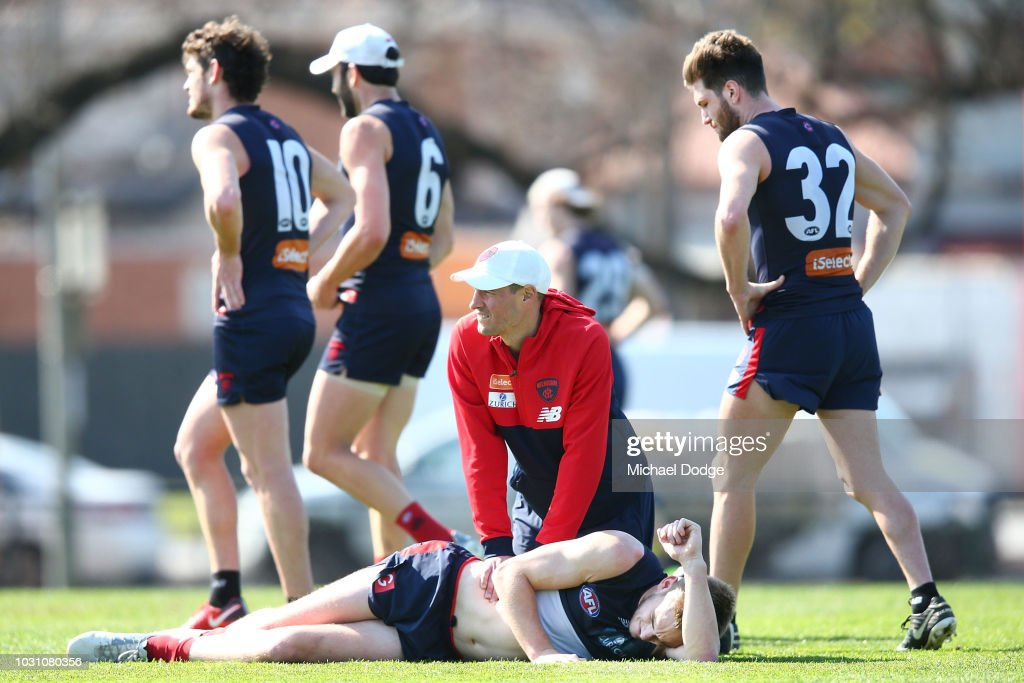 Oscar McDonald of the Demons gets attended to by a trainer during a Melbourne Demons AFL training session at Gosch's Paddock on September 11, 2018 in Melbourne, Australia.