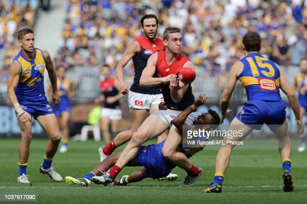 Oscar McDonald of the Demons handpasses the ball during the AFL Prelimary Final match between the West Coast Eagles and the Melbourne Demons on...