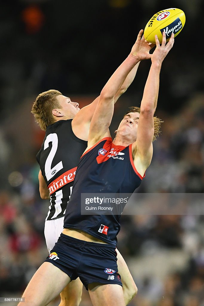 Oscar McDonald of the Demons marks infront of Jordan de Goey of the Magpies during the round 12 AFL match between the Melbourne Demons and the Collingwood Magpies at Melbourne Cricket Ground on June 13, 2016 in Melbourne, Australia.