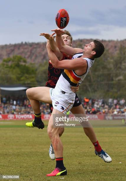 Oscar McDonald of the Demons spoils a mark by Josh Jenkins of the Crows during the round 10 AFL match between the Melbourne Demons and the Adelaide...