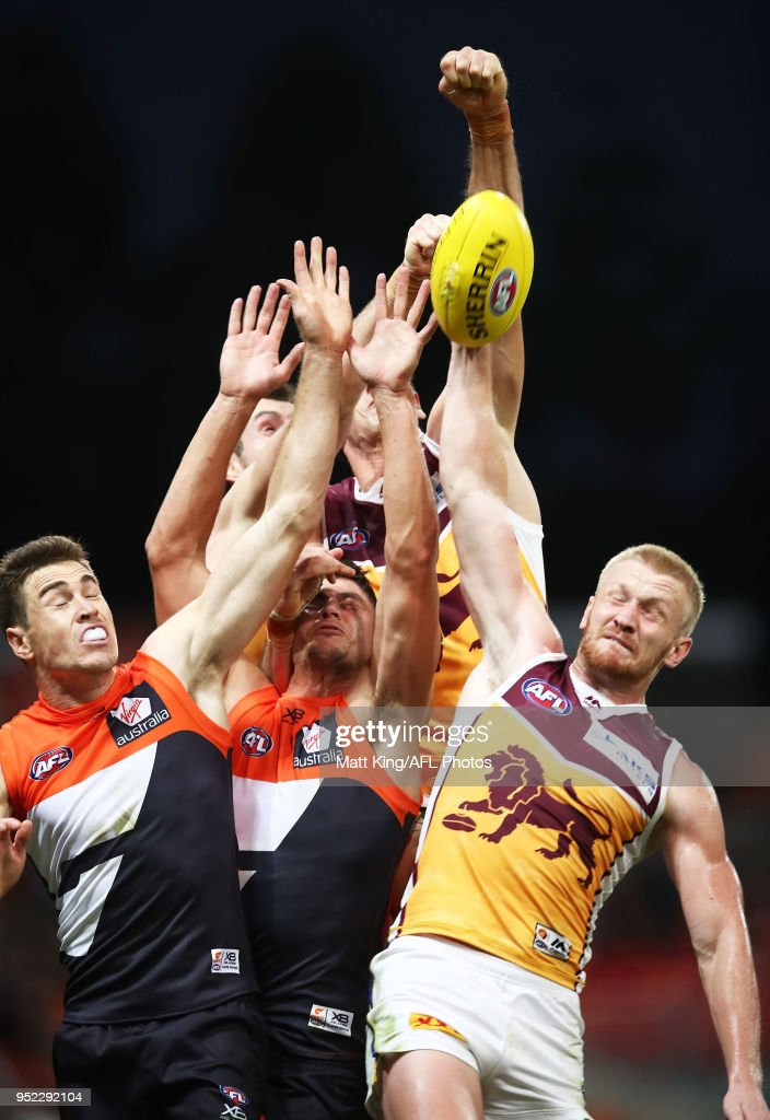 Oscar McInerney (top) and Nick Robertson (bottom) of the Lions compete against Jeremy Cameron (L) and Jonathon Patton (R) of the Giants during the round six AFL match between the Greater Western Sydney Giants and the Brisbane Lions at Spotless Stadium on April 28, 2018 in Sydney, Australia.