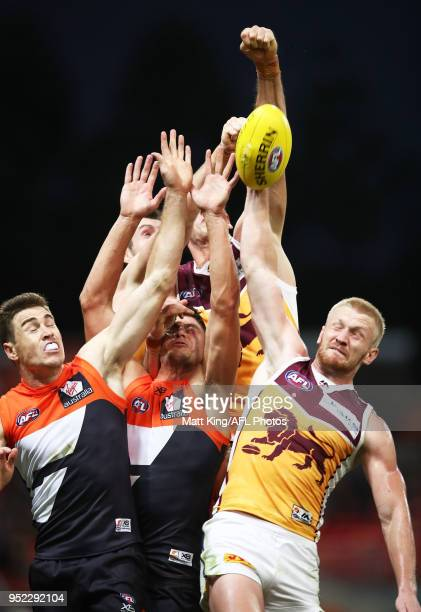 Oscar McInerney and Nick Robertson of the Lions compete against Jeremy Cameron and Jonathon Patton of the Giants during the round six AFL match...