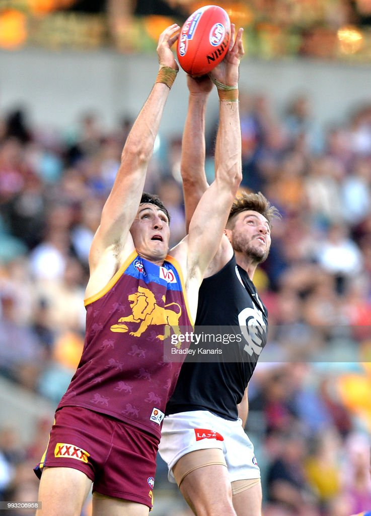 Oscar McInerney of the Lions and Dale Thomas of Carlton challenge for the mark during the round 16 AFL match between the Brisbane Lions and the Carlton Blues at The Gabba on July 7, 2018 in Brisbane, Australia.