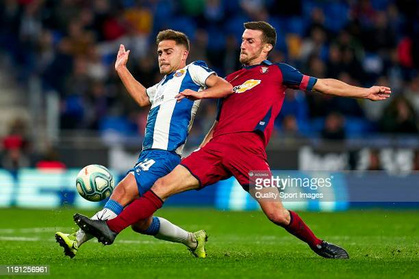 Oscar Melendo of RCD Espanyol competes for the ball with Oier Sanjurjo of CA Osasuna during the Liga match between RCD Espanyol and CA Osasuna at...