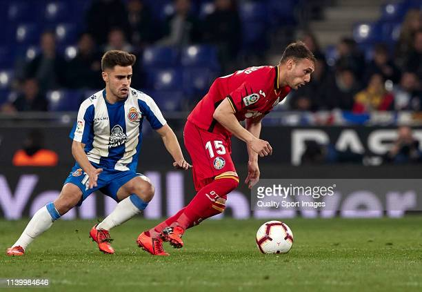 Oscar Melendo of RCD Espanyol competes for the ball with Sebastian Cristoforo of Getafe CF during the La Liga match between RCD Espanyol and Getafe...