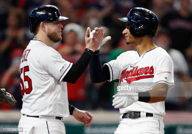 Oscar Mercado and Roberto Perez of the Cleveland Indians celebrate Mercado's three run home run against the Philadelphia Phillies in the fifth inning...