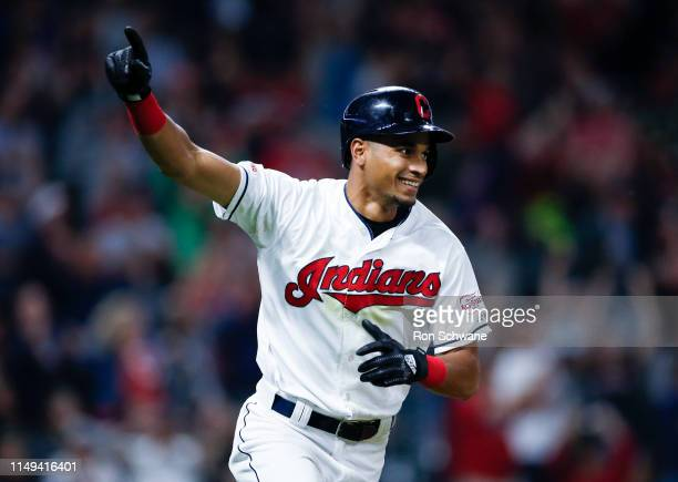 Oscar Mercado of the Cleveland Indians celebrates after hitting the game winning single off Raisel Iglesias of the Cincinnati Reds during the tenth...