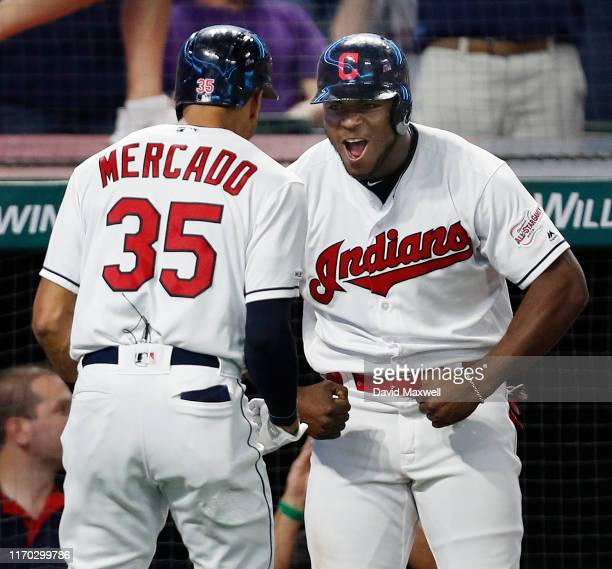 Oscar Mercado of the Cleveland Indians celebrates his three run home run against the Philadelphia Phillies with Yasiel Puig as he returns to the...