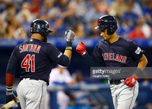 Oscar Mercado of the Cleveland Indians celebrates with Carlos Santana after hitting a home run in the eighth inning during a MLB game against the...