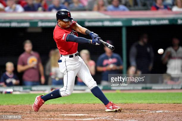 Oscar Mercado of the Cleveland Indians hits an RBI single during the fifth inning against the Detroit Tigers at Progressive Field on September 19...