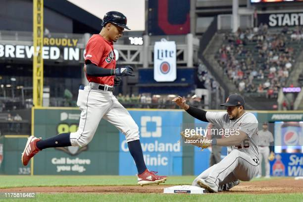 Oscar Mercado of the Cleveland Indians is out at first as first baseman Jeimer Candelario of the Detroit Tigers stumbles making the tag during the...