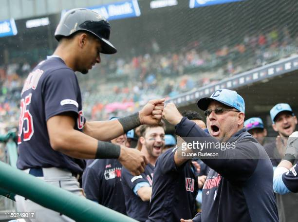 Oscar Mercado of the Cleveland Indians receives a fist bump from manager Terry Francona of the Cleveland Indians after scoring on a home run hit...