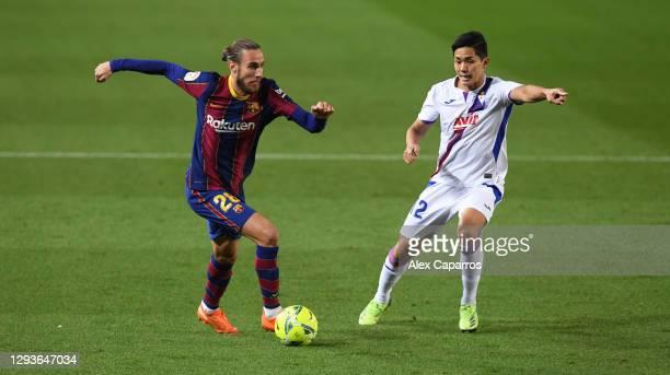 Oscar Mingueza of Barcelona runs past Ricard 'Riqui' Puig of SD Eibar during the La Liga Santander match between FC Barcelona and SD Eibar at Camp...