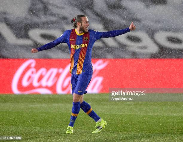 Oscar Mingueza of FC Barcelona celebrates after scoring their side's first goal during the La Liga Santander match between Real Madrid and FC...