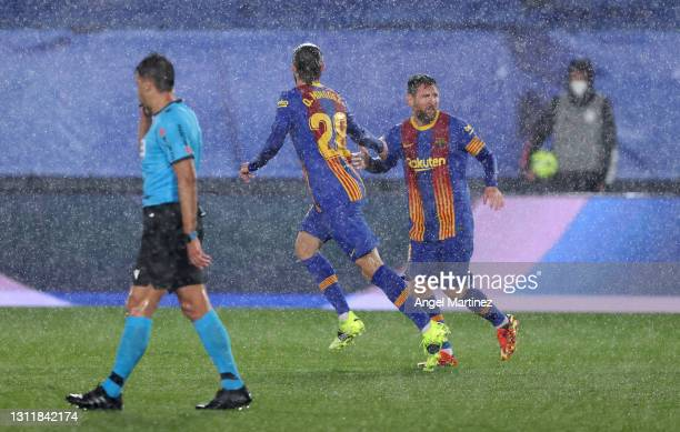 Oscar Mingueza of FC Barcelona celebrates with team mate Lionel Messi after scoring their side's first goal during the La Liga Santander match...