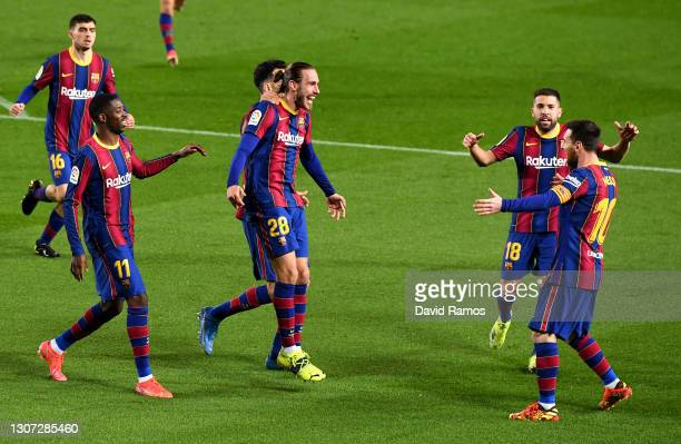 Oscar Mingueza of FC Barcelona celebrates with team mates Ousmane Dembele, Jordi Alba and Lionel Messi after scoring their side's third goal during...