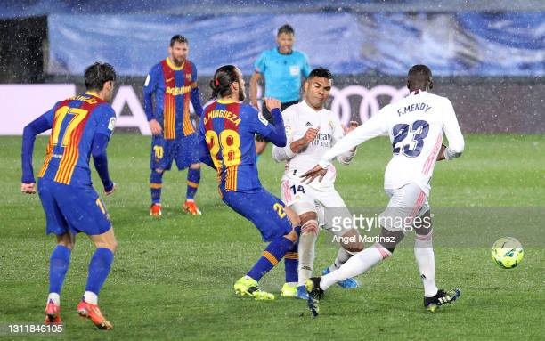 Oscar Mingueza of FC Barcelona is fouled by Casemiro of Real Madrid which led to a second yellow card and consequently a red card resulting in...