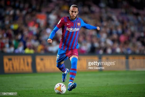Oscar Mingueza of FC Barcelona kicks the ball during the LaLiga Santander match between FC Barcelona and Valencia CF at Camp Nou on October 17, 2021...