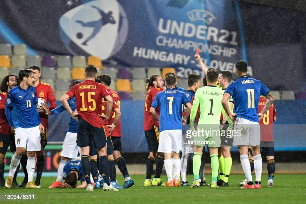 Oscar Mingueza of Spain is shown a red card and sent off by referee Harm Osmers during the 2021 UEFA European Under-21 Championship Group B match...