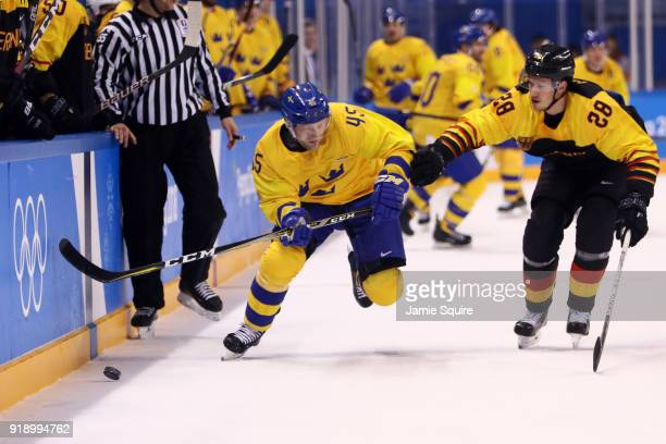 Oscar Moller of Sweden skates against Frank Mauer of Germany during the Men's Ice Hockey Preliminary Round Group C game at Kwandong Hockey Centre on...