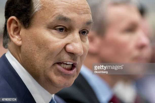 Oscar Munoz chief executive officer of United Continental Holdings Inc speaks during a House Transportation and Infrastructure Committee hearing in...